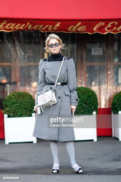 Caroline Daur wears a gray dress a white bag gray wool tights sandals outside Proenza Schouler during Paris Fashion Week Haute Couture Spring/Summer...