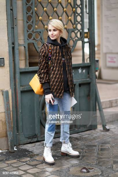 Caroline Daur wears a jacket blue jeans white shoes during Paris Fashion Week Womenswear Fall/Winter 2018/2019 on March 1 2018 in Paris France