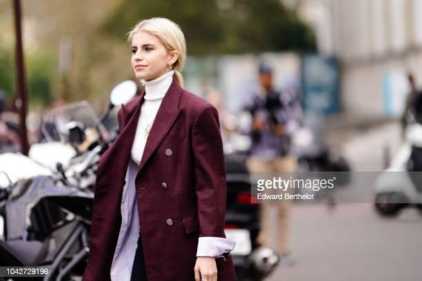Caroline Daur wears a purple blazer jacket a white turtleneck black pants white shoes outside Issey Miyake during Paris Fashion Week Womenswear...