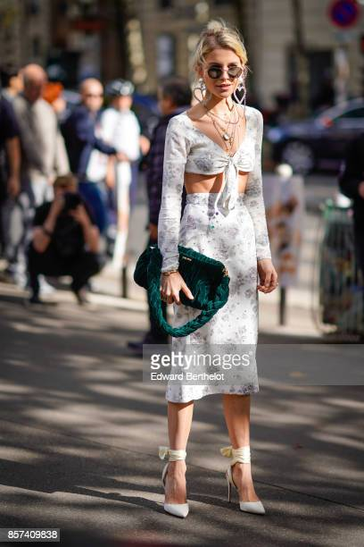 Caroline Daur wears a skirt a bare belly top a green bag outside Miu Miu during Paris Fashion Week Womenswear Spring/Summer 2018 on October 3 2017 in...