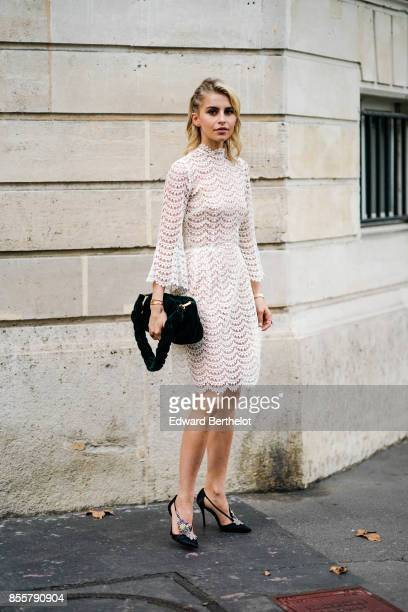 Caroline Daur wears a white dress outside Kaviar Gauche during Paris Fashion Week Womenswear Spring/Summer 2018 on September 29 2017 in Paris France