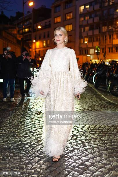 Caroline Daur wears a white dress with a fluffy part, outside Valentino, during Paris Fashion Week - Haute Couture Spring/Summer 2020, on January 22,...