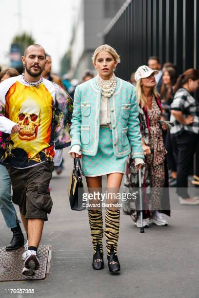Caroline Daur wears earrings pearl necklaces a Gucci white top a light green Gucci jacket an assorted mini skirt a yellow and black handbag Gucci...