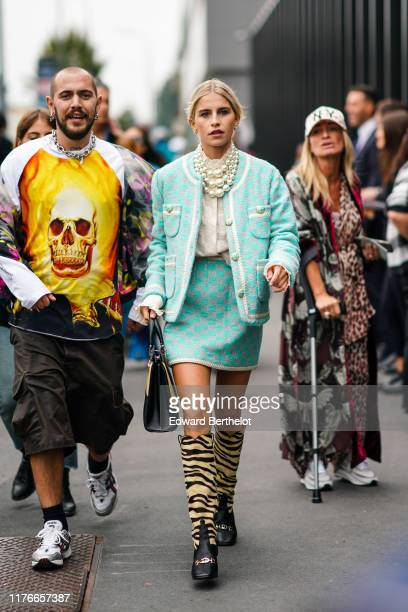 Caroline Daur wears earrings, pearl necklaces, a Gucci white top, a light green Gucci jacket, an assorted mini skirt, a yellow and black handbag,...