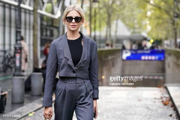 Caroline Daur wears sunglasses a black top a grey jacket grey pants outside Koche during Paris Fashion Week Womenswear Spring Summer 2020 on...