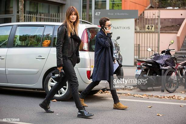 Caroline de Maigret and Agathe Mougin enter the Anthony Vaccarello show on September 23 2014 at Les Docks in Paris France Caroline wears an Anthony...