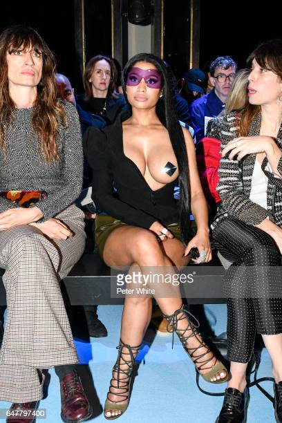 Caroline de Maigret and Nicki Minaj attends the Haider Ackermann show as part of the Paris Fashion Week Womenswear Fall/Winter 2017/2018 on March 4...