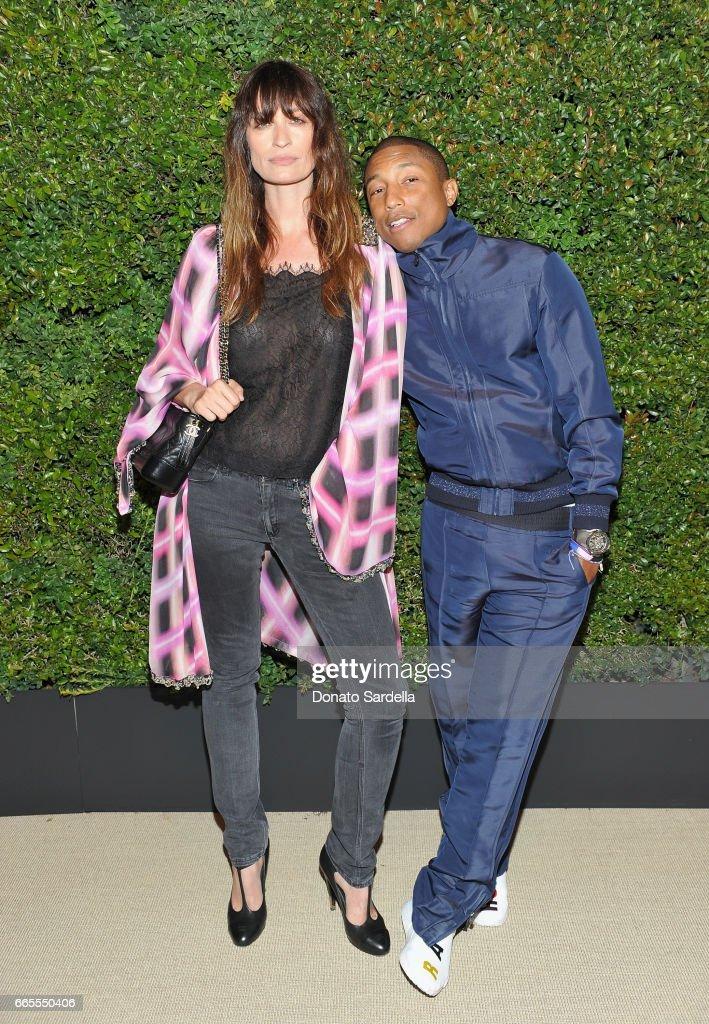 Caroline De Maigret and Pharrell Williams attend Caroline De Maigret and Pharrell Williams dinner in celebration of CHANEL's Gabrielle Bag at Giorgio Baldi on April 6, 2017 in Santa Monica, California.