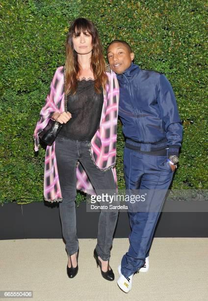 Caroline De Maigret and Pharrell Williams attend Caroline De Maigret and Pharrell Williams dinner in celebration of CHANEL's Gabrielle Bag at Giorgio...
