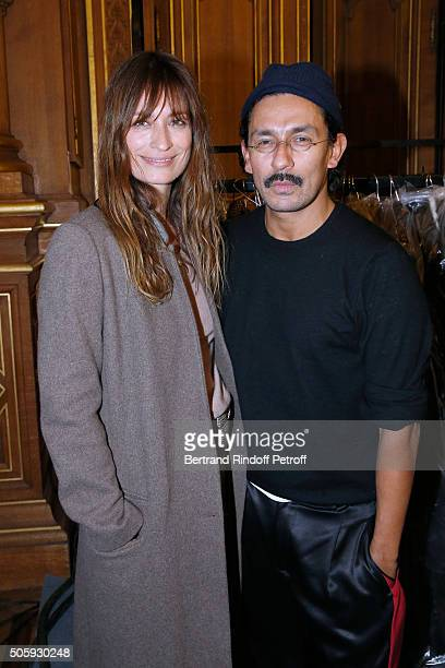 Caroline de Maigret and Stylist Haider Ackermann pose Backstage after the Haider Ackermann Menswear Fall/Winter 20162017 show as part of Paris...