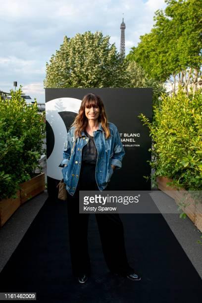 Caroline de Maigret attends the Noir et Blanc de Chanel Fall/Winter 2019 Makeup Collection Yachts De Paris on July 11 2019 in Paris France
