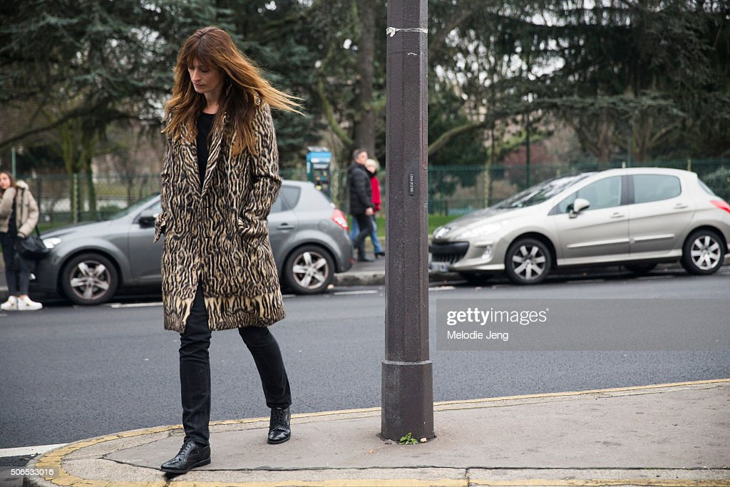 Caroline de Maigret exits the Dior Homme show in an animal-print coat on January 23, 2016 in Paris, France.