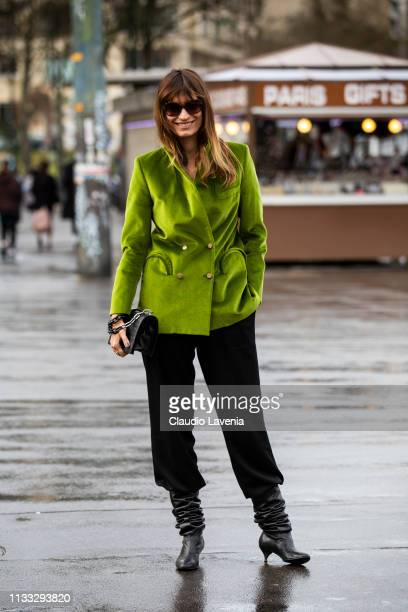 Caroline de Maigret wearing a green velvet blazer black pants black boots and black bag is seen outside Haider Ackermann on Day 6 Paris Fashion Week...