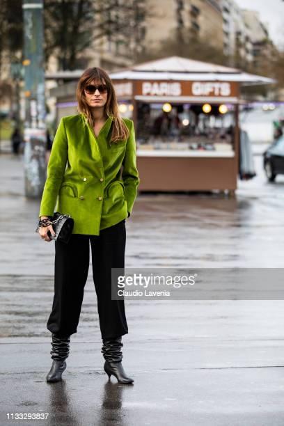 Caroline de Maigret wearing a green velvet blazer black pants black boots and black bag is seen outside Haider Ackermann on Day 6 Paris Fashion Week...