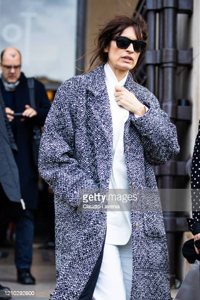 Caroline de Maigret wearing a white shirt white pants and black and white coat is seen outside Haider Ackermann during Paris Fashion Week Womenswear...