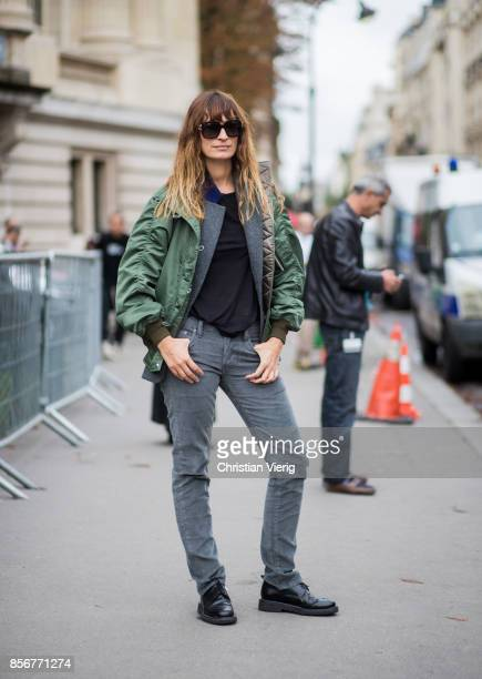Caroline de Maigret wearing green bomber jacket seen outside Sacai during Paris Fashion Week Spring/Summer 2018 on October 2 2017 in Paris France