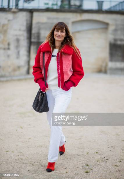 Caroline de Maigret wearing red teddy jacket white pants is seen outside Lacoste during Paris Fashion Week Spring/Summer 2018 on September 27 2017 in...