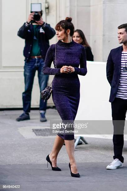 Caroline de Maigret wears a blue dress outside the Chanel Cruise 2018/2019 Collection at Le Grand Palais on May 03 2018 in Paris France