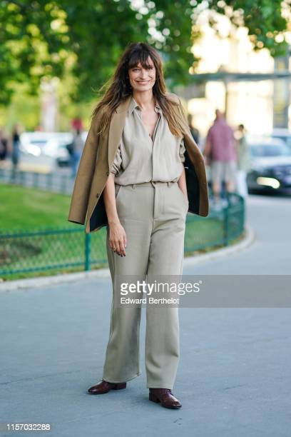 Caroline de Maigret wears a camel jacket, a light khaki shirt, light khaki pants, burgundy flat shoes, outside AMI, during Paris Fashion Week -...