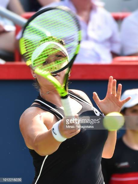 Caroline Dolehide hits a return against Venus Williams during day one of the Rogers Cup at IGA Stadium on August 6 2018 in Montreal Quebec Canada