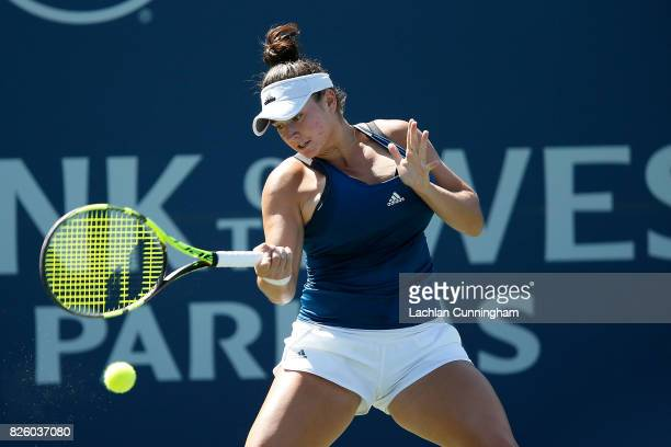 Caroline Dolehide of the United States competes against Naomi Osaka of Japan during day 2 of the Bank of the West Classic at Stanford University...