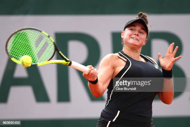 Caroline Dolehide of The United States plays a forehand during the ladies singles second round match against Madison Keys of The United States during...