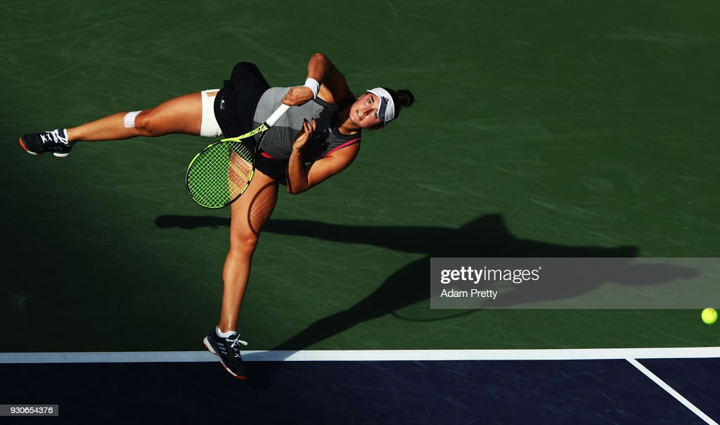 Caroline Dolehide of the USA serves during her match against Simona Halep of Romania during the BNP Paribas Open at the Indian Wells Tennis Garden of the Czech Republic on March 11, 2018 in Indian Wells, California.