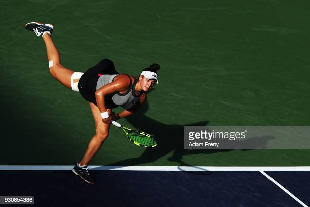 Caroline Dolehide of the USA serves during her match against Simona Halep of Romania during the BNP Paribas Open at the Indian Wells Tennis Garden of...