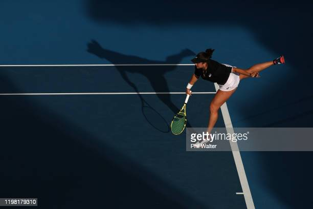 Caroline Dolehide of the USA serves with Johanna Larsson of Sweden during their doubles match against Caroline Wozniacki of Denmark and Serena...