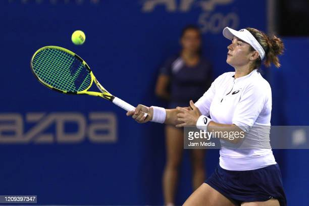 Caroline Dolehide of USA returns the ball during the doubles match between Caroline Dolehide of USA and Astra Sharma of Australia and Desirae...