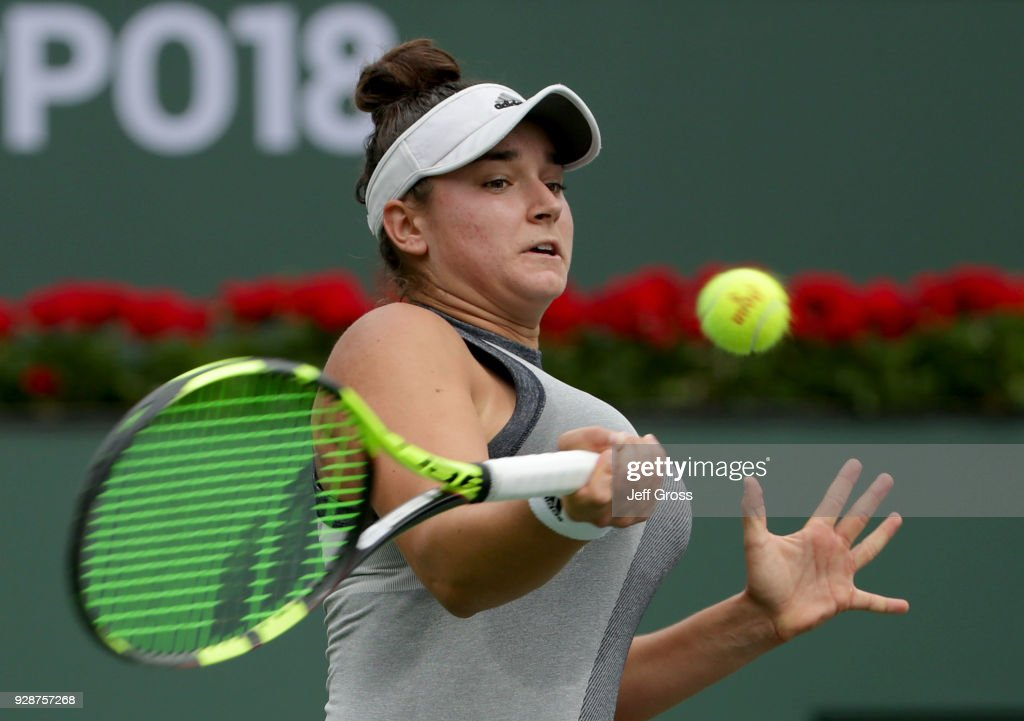 Caroline Dolehide returns a forehand to Shelby Rogers during the first round of the BNP Paribas Open at the Indian Wells Tennis Garden on March 7, 2018 in Indian Wells, California.