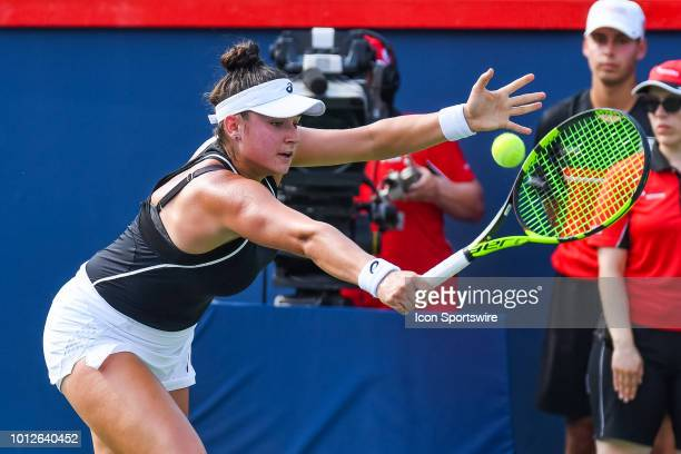 Caroline Dolehide returns the ball during her first round match at WTA Coupe Rogers on August 6 2018 at IGA Stadium in Montréal QC