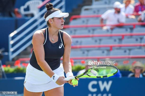 Caroline Dolehide serves the ball during her first round match at WTA Coupe Rogers on August 6 2018 at IGA Stadium in Montréal QC