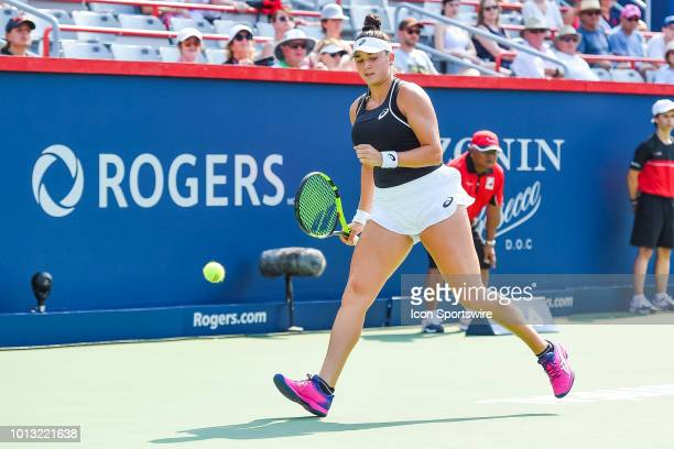 Caroline Dolehide shows pride after scoring a point during her first round match at WTA Coupe Rogers on August 6 2018 at IGA Stadium in Montréal QC