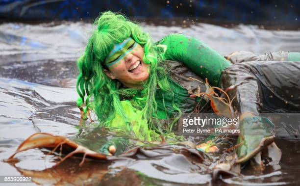 Caroline Eccles and Megan Hayhurst take part in the World Gravy Wrestling Championships at the Rose n Bowl Stackteads in Lancashire
