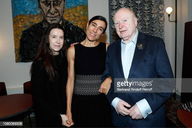 Caroline FabreBazin Bianca Li and Christoph von Weyhe pose in front of a portrait of Azzedine Alaia by Julian Schnabel during Alaia Foundation...