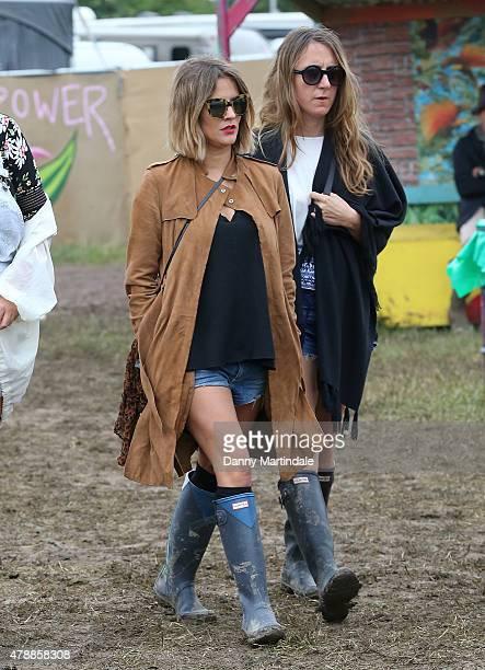 Caroline Flack and friend at the Glastonbury Festival at Worthy Farm Pilton on June 28 2015 in Glastonbury England