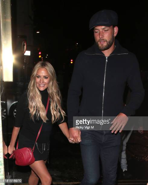 Caroline Flack and Lewis Burton seen at Sexy Fish restaurant in Mayfair on October 16 2019 in London England