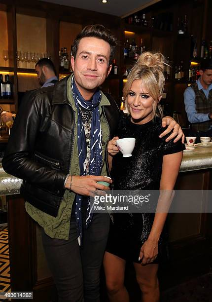 Caroline Flack and Nick Grimshaw attend the launch of Caroline Flack's new autobiography Storm In A C Cup at Library on October 21 2015 in London...