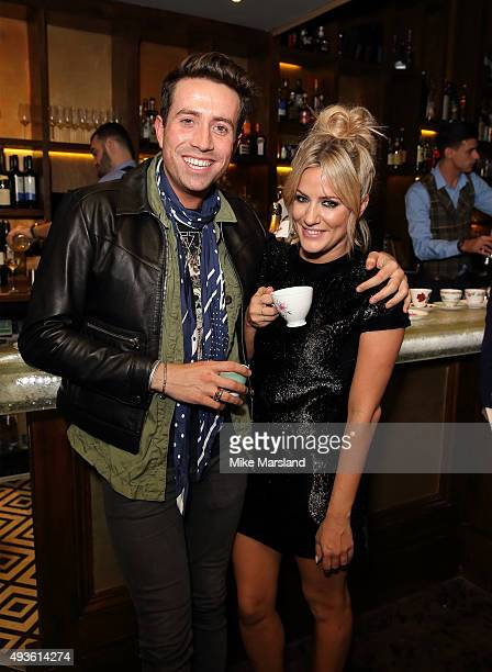 Caroline Flack and Nick Grimshaw attend the launch of Caroline Flack's new autobiography 'Storm In A C Cup' at Library on October 21 2015 in London...