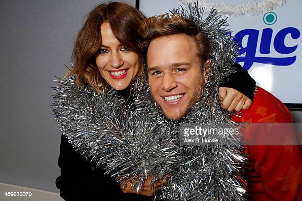 Caroline Flack and Olly Murrs pictured during a visit to the Magic Radio Studios on November 27 2014 in London England Photo by Alex Huckle/Getty...