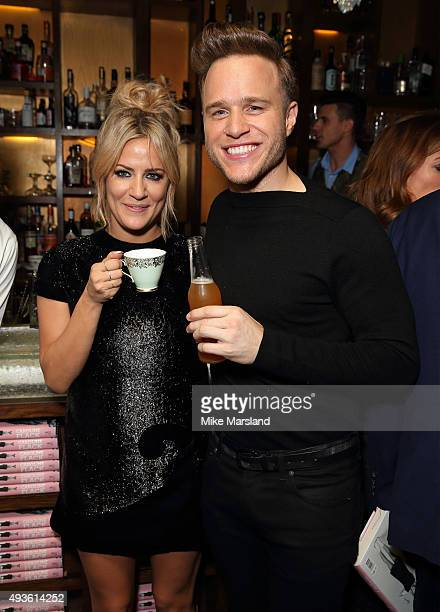 Caroline Flack and Olly Murs attend the launch of Caroline Flack's new autobiography Storm In A C Cup at Library on October 21 2015 in London England