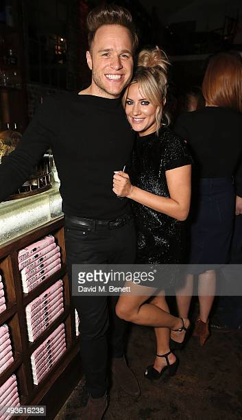 Caroline Flack and Olly Murs attend the launch of Caroline Flack's new book Storm In A C Cup at Library on October 21 2015 in London England