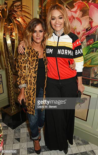 Caroline Flack and Rita Ora attend the adidas Originals by Rita Ora dinner at The Ivy Chelsea Garden on November 23 2016 in London England