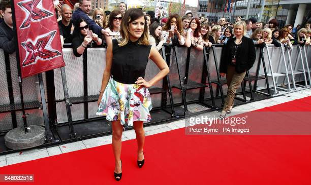 Caroline Flack arrives on the red carpet for the first round of X Factor auditions at the Echo Arena Liverpool