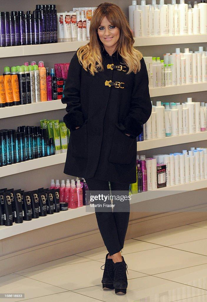 Caroline Flack has a festive fringe cut at Regis Salons in Jenners Edinburgh, wearing the Miu Miu coat received as a birthday present from Olly Murs on December 21, 2012 in Edinburgh, Scotland.