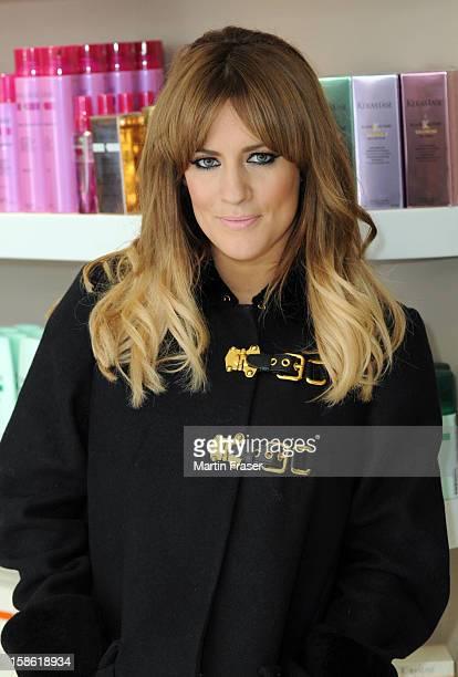 Caroline Flack has a festive fringe cut at Regis Salons in Jenners Edinburgh wearing the Miu Miu coat received as a birthday present from Olly Murs...