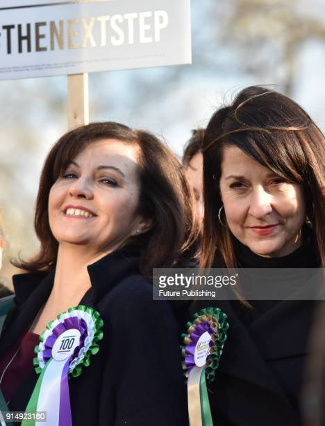 Caroline Flint Liz Kendall Female members of the shadow cabinet and Labour politicians wearing suffrage rosettes and banners stand outside the Houses...