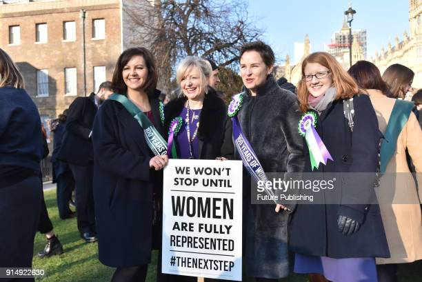 Caroline Flint Mary Creagh Female members of the shadow cabinet and Labour politicians wearing suffrage rosettes and banners stand outside the Houses...