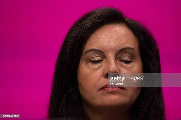 Caroline Flint the Shadow Environment Minister sits on stage in the main conference hall on day three of the Labour Party Conference on September 23...